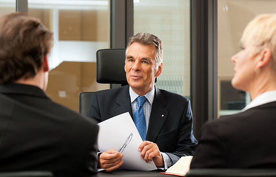 Lawyer with clients in a meeting